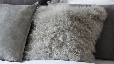 Choosing different fabrics and grey tones in styling the bed.