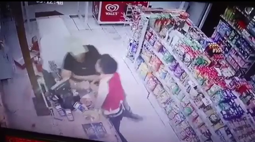CCTV appears to show the man in an altercation with the employee. (Supplied)