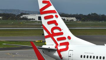 A Boeing 737-800 is seen at the Virgin Australia Airlines terminal at Adelaide Airport in Adelaide.