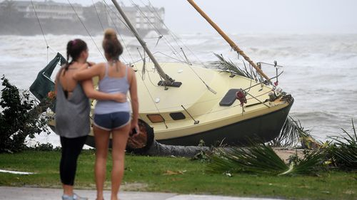 A boat is seen washed ashore at Airlie Beach after Cyclone Debbie hit Queensland's far north coast yesterday as a category 4 cyclone, causing widespread damage. (AAP)