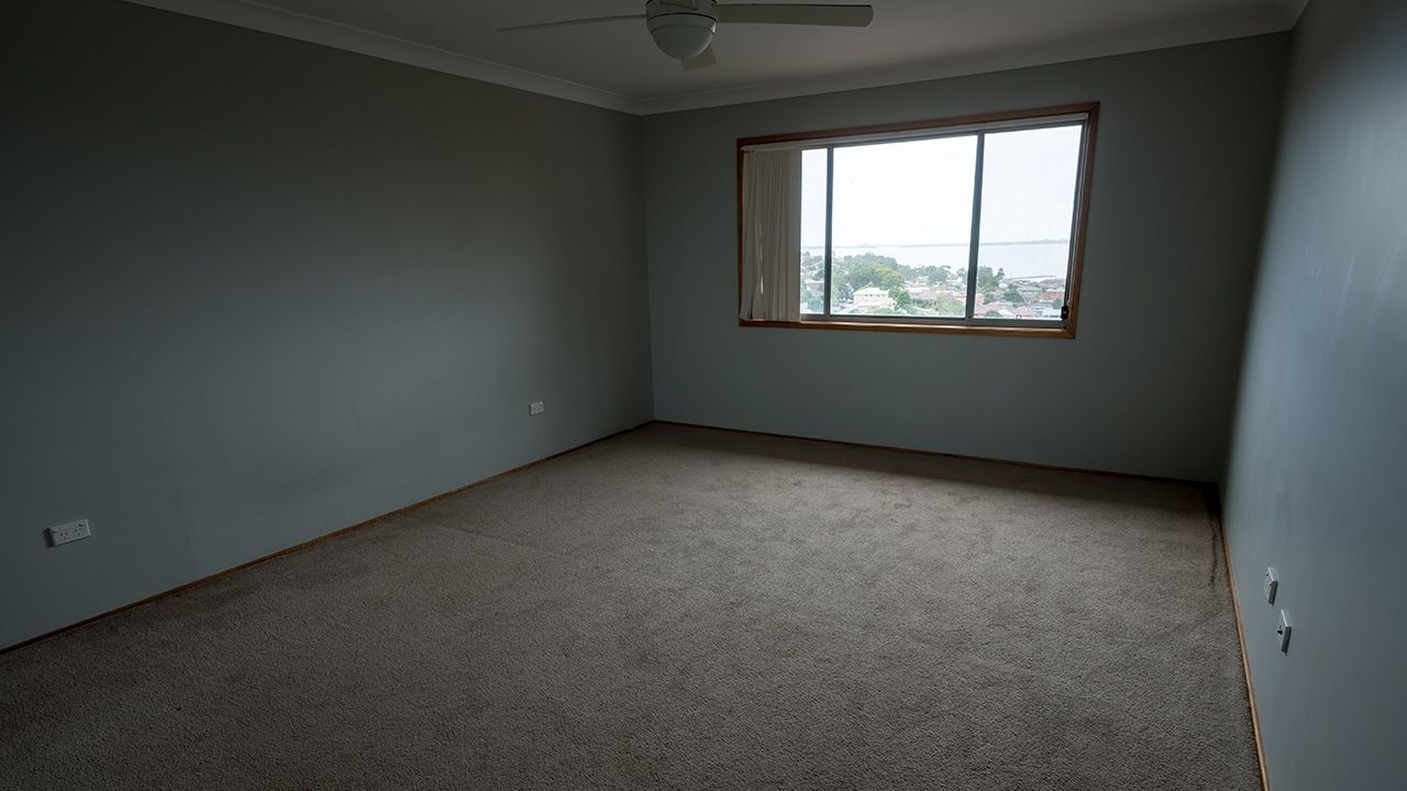 BEFORE: One of the dark bedrooms in need of some brightening up