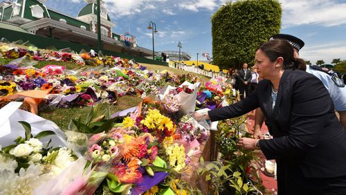 Mourners pay tribute to the four victims in the Dreamworld disaster.