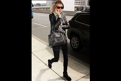 We rarely (read: never) see an outfit on Gisele Bundchen we don't adore, but it might take several months' worth of pay checks to imitate her airport style.<br/><br/>The supermodel was snapped leaving LAX in this $2000 Helmut Lang biker jacket and $920 Isabel Marant sneakers. Oh to be young, gorgeous and wickedly wealthy …<br/>