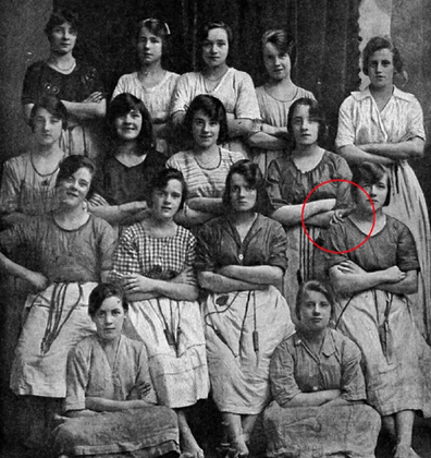 The hand doesn't seem to belong to any of the girls pictured.