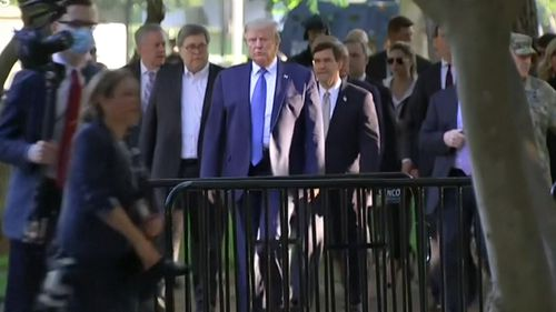 US President Donald Trump leaves the safety of the White House and makes his way to to St John's church.