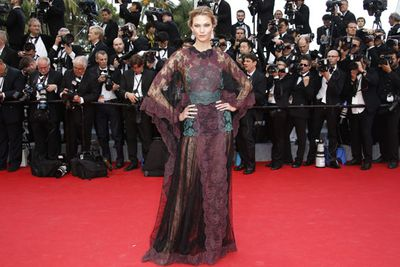 Even Karlie seems underwhelmed by this huge lace frock!
