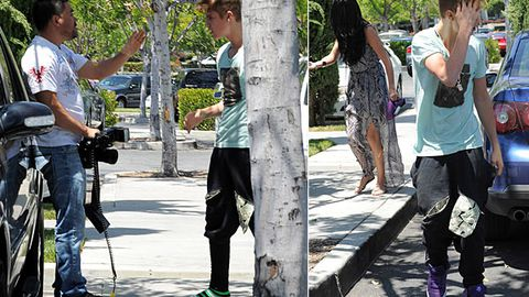 Justin Bieber loses shoe in punch up with paparazzi