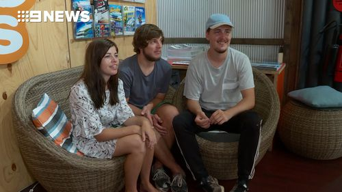 Alexander Jensen, Julie Lelund and Neikolaj Nielsen had been travelling around Australia for six months when they were stopped in their tracks. (9NEWS)