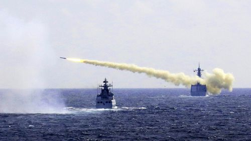A missile is launched from a navy ship during a live ammunition drill in the East China Sea. China's navy has fired dozens of missiles and torpedoes during exercises in the East China Sea that come amid heightened maritime tensions in the region, underscoring Beijing's determination to back up its sovereignty claims with force if needed. (AAP / April, 2016)