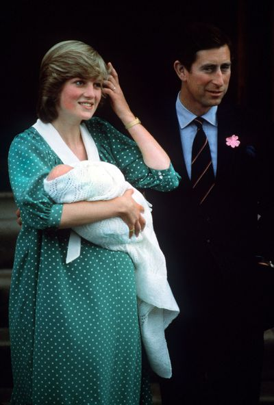 The Prince and Princess of Wales with their newborn son Prince William in London, 1982.