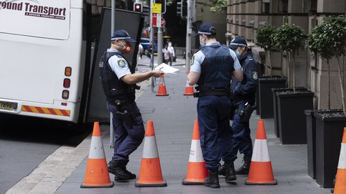 Police officers pictured outside one of the Sydney quarantine hotels.