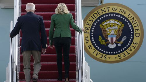 President Joe Biden and first lady Jill Biden walk up the steps of Air Force One at Andrews Air Force Base, Md., Friday, Feb. 26, 2021