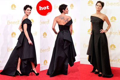 <i>Game of Thrones</i> star Lena Headey shows off her tattoos in this gorgeous layered gown.