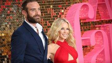Kylie Minogue's fiance says the pair won't walk down the aisle until same-sex marriage is legalised in Australia. (AAP)