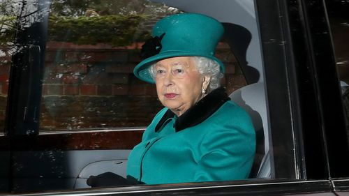Queen Elizabeth II is driven away after attending a Sunday service at St Mary Magdalene church on the Royal Sandringham estate in Norfolk. (AAP)