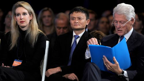 Holmes with Alibaba founder Jack Ma and former US president Bill Clinton in 2015. (PA/AAP)