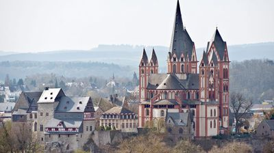 A general view over former Bishop Tebartz-Van Elst's residence (L) and the cathedral (R) of Limburg, Germany. (AAP)