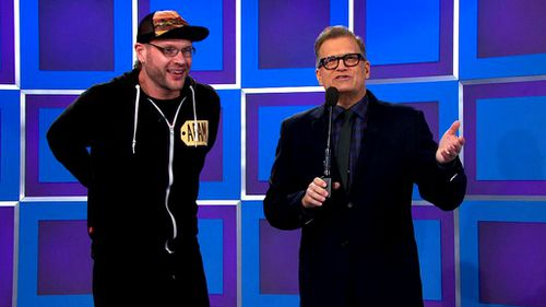 The guitarist and back-up vocalist with the show's host Drew Carey. (Twitter - @ThePriceIsRight)