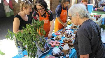 Voters are treated with a cake stall at Stanmore Public School in Sydney's inner-west on NSW state election day. (AAP)