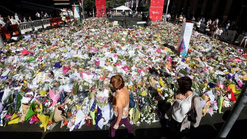 Tributes in Martin Place following the siege four years ago.