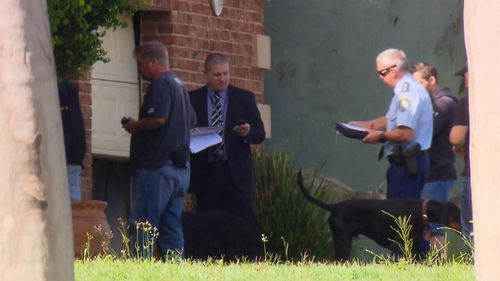 Firearm parts, drugs, and unauthorised reptiles were seized during this morning's raids. (9NEWS)