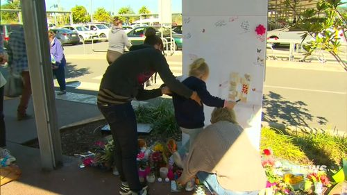 Indie's heartbroken best friend Aylah left a touching tribute on a memorial at the scene. Picture: 9NEWS
