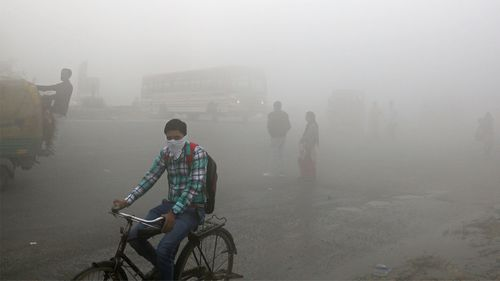 A thick blanket of smog on the outskirts of New Delhi, India.
