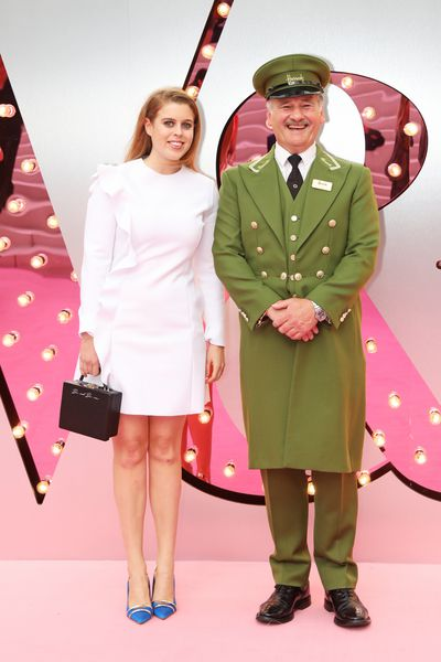 Princess Beatrice poses with the Harrod's Green Man