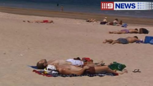 Beachgoers take advantage of the heat in Adelaide, with temperatures set to top 42C in the city today. (9NEWS)