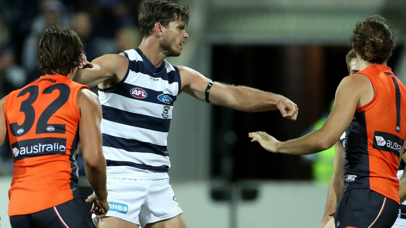 Geelong Cats forward Tom Hawkins cops one-match AFL ban for umpire contact