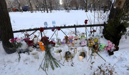 Toys, candles and flowers lie at the scene of a collapsed apartment building in Magnitogorsk, a city of 400,000 people, about 1,400 kilometers (870 miles) southeast of Moscow, Russia.