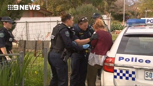 Police arrived at the Edith Street home to find a man with wounds to his back and a woman with cuts to her hands.