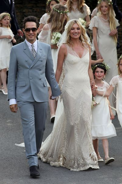 <p>Kate Moss and Jamie Hinc, 2011</p> <p>The bride wore - John Galliano</p>