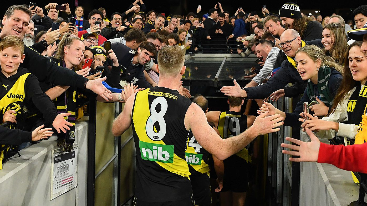 Jack Riewoldt of the Tigers high fives fans after winning the round seven AFL match between the Richmond Tigers and the Western Bulldogs at Melbourne Cricket Ground on April 30, 2021 in Melbourne, Australia. (Photo by Quinn Rooney/Getty Images)