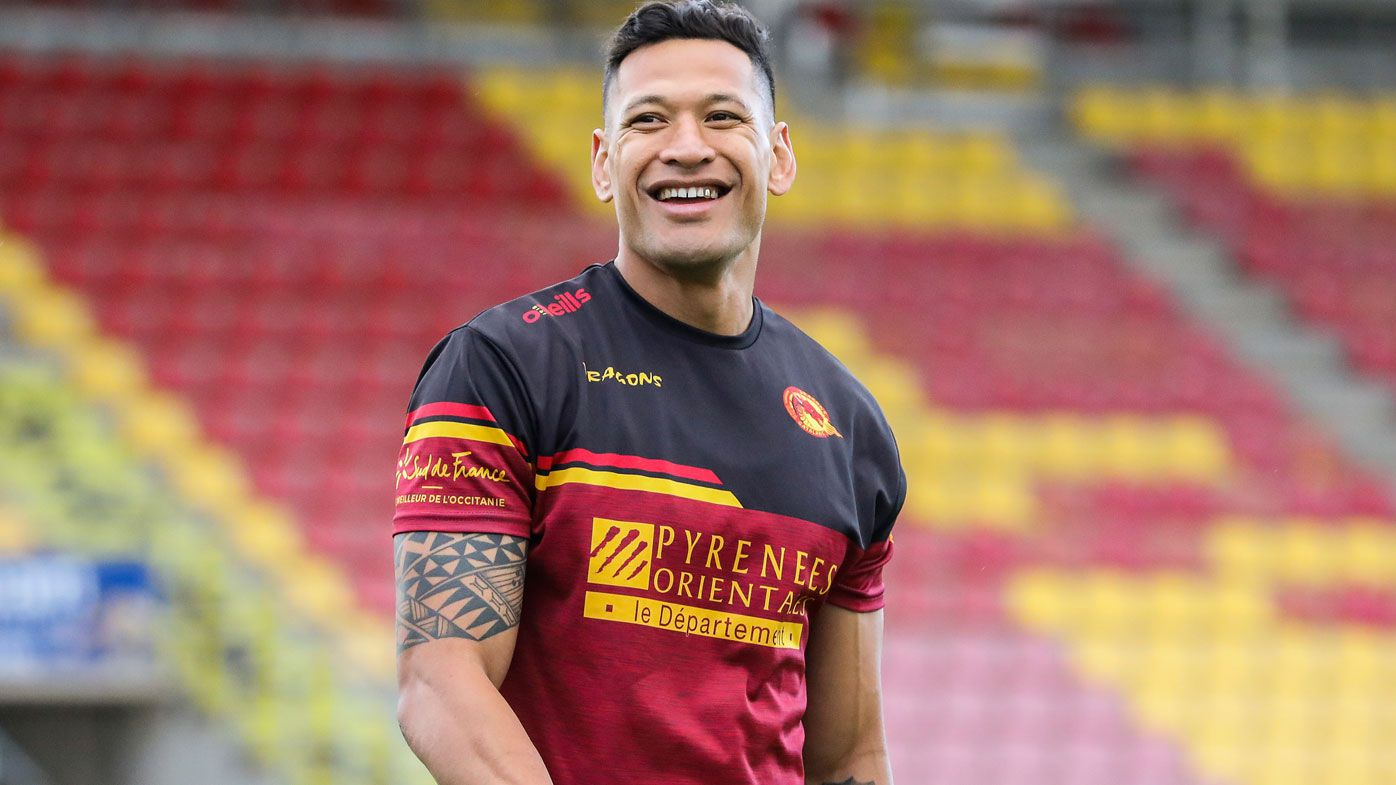 Australian rugby player Israel Folau smiles during a training session with his new club Catalan Dragons in Perpignan