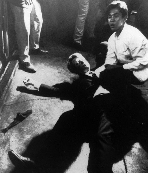 Senator Robert Kennedy awaits medical assistance as he lies on the floor of the Ambassador hotel in Los Angeles moments after he was shot June 5, 1968. (AAP)