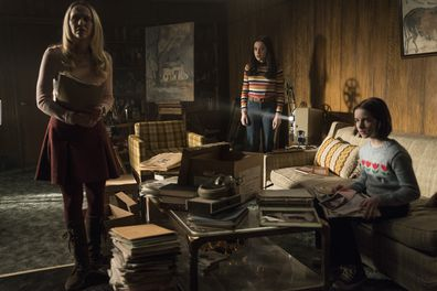 (L - R) Madison Iseman, Katie Sarife and Mckenna Grace in a scene from Annabelle Comes Home.