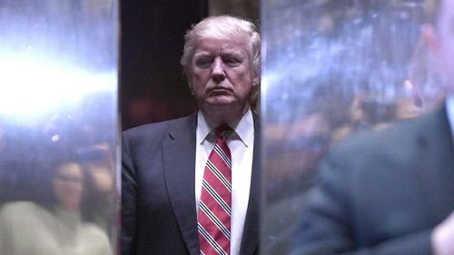 President Donald Trump enters the lift in Trump Tower. (AAP)