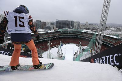 Snowboarder Katie Ormerod, of Britain, looks down towards home plate at Fenway Park before making a practice jump. (AAP)