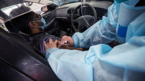 A nurse administers the Pfizer COVID-19 vaccine at the new drive through vaccination centre in Melton, Melbourne.
