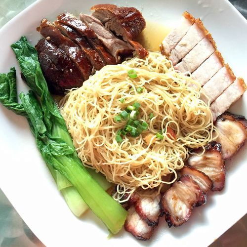 Hawker Chan is dishing up meals like this roast crispy pork and barbecue pork on noodles. (Facebook)