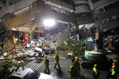 Rescue workers have worked through the night to find people trapped in the building. (AAP)