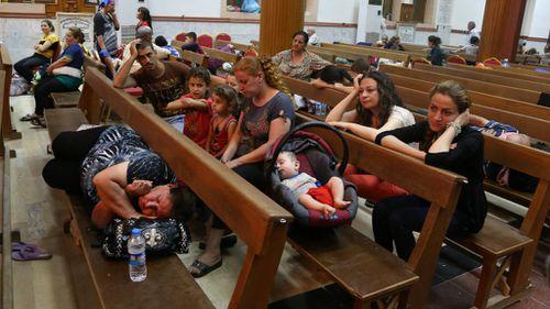 Displaced Iraqi Christians settle at St Joseph Church in Irbil, northern Iraq. Picture: AP