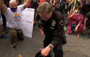 LA police officer unites protesters in touching display of solidarity