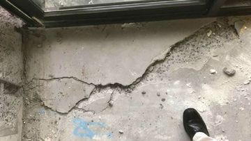 Residents in Sydney's Opal Tower reported hearing loud bangs before the cracks were found.