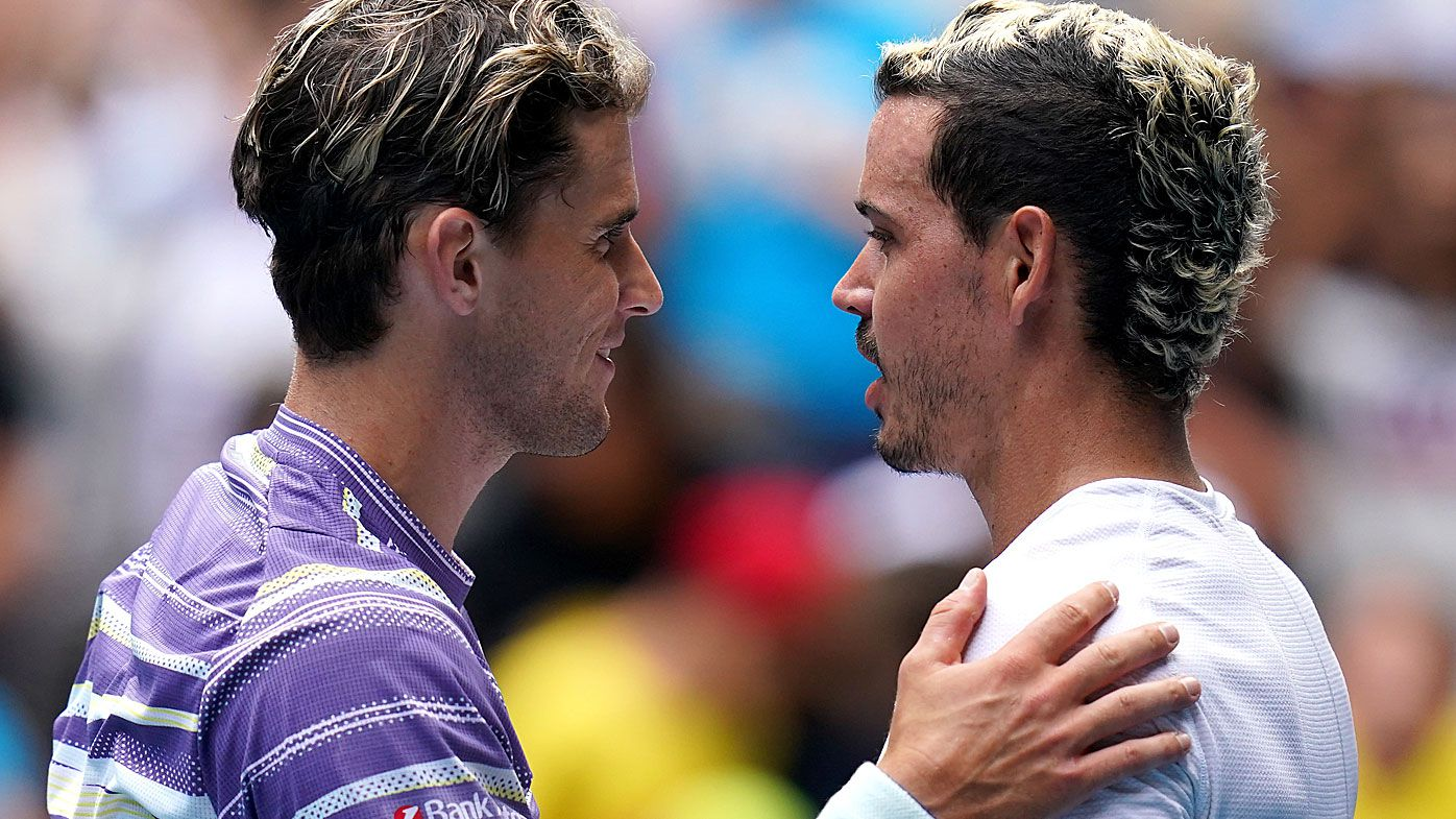 Dominic Thiem of Austria and Alex Bolt of Australia meet at the net after their second round match