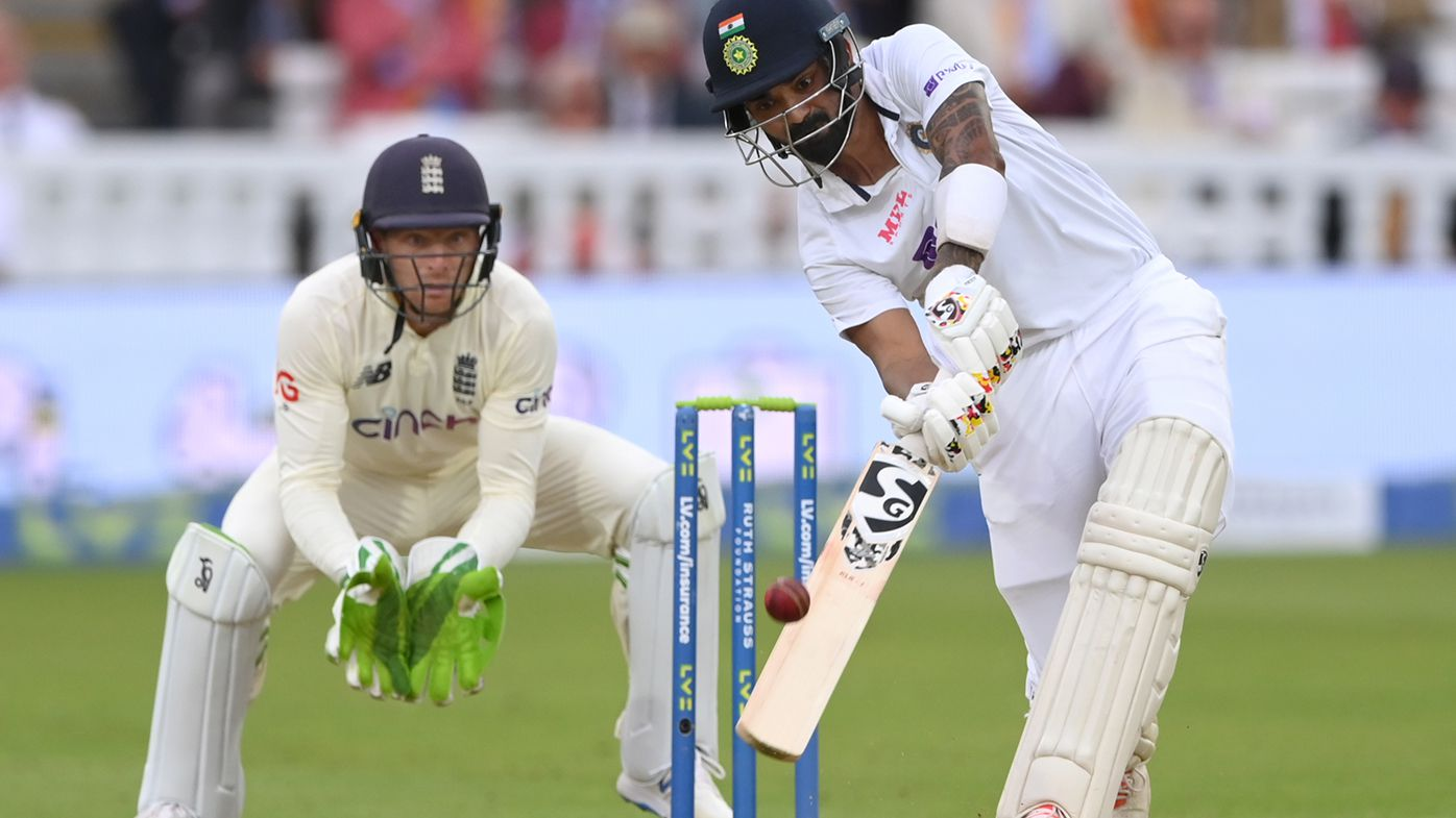 Indian batsman KL Rahul hits a ball from Moeen Ali for 6 runs watched by Jos Buttler during day one of the Second Test Match between England and India at Lord's.