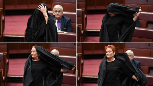 Senator Hanson removed the burqa before speaking. (AAP)