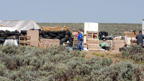 Police are investigating what went on at the New Mexico compound, but believe children were trained for school shootings.