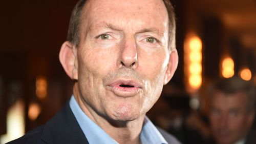 Former Prime Minister Tony Abbott speaks with Liberal Party members at the NSW Liberal State Council in Sydney. (AAP)